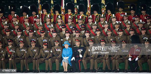 Queen Elizabeth II attends a ceremony to present new colours to the Royal Welsh Guard at Millennium Stadium on June 11 2015 in Cardiff Wales