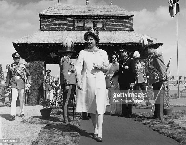 Queen Elizabeth II attends a civic reception with King Mahendra of Nepal and Queen Ratna of Nepal behind at the Parade Ground after their arrival in...