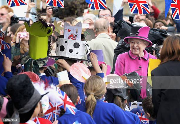 Queen Elizabeth II attends a 'Mad Hatters tea party' at Sherborne Abbey on May 1 2012 in Sherborne England The Queen and Duke of Edinburgh are...
