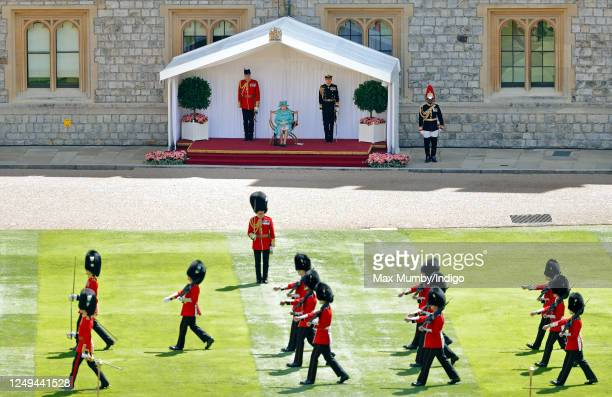 Queen Elizabeth II attends a military ceremony in the Quadrangle of Windsor Castle to mark her Official Birthday on June 13, 2020 in Windsor,...