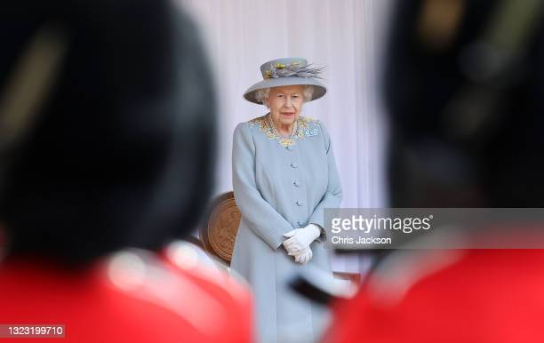 Queen Elizabeth II attends a military ceremony in the Quadrangle of Windsor Castle to mark her Official Birthday on June 12, 2021 at Windsor Castle...