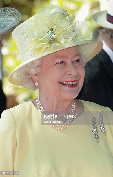 Queen Elizabeth II attends a reception at the Ambassador's residence on November 27 2010 in Muscat Oman Queen Elizabeth II and Prince Philip Duke of...