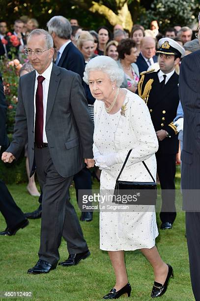 Queen Elizabeth II attends a reception at the British Embassy during an Official visit in Paris ahead of the 70th Anniversary Of The D-Day on June 5,...