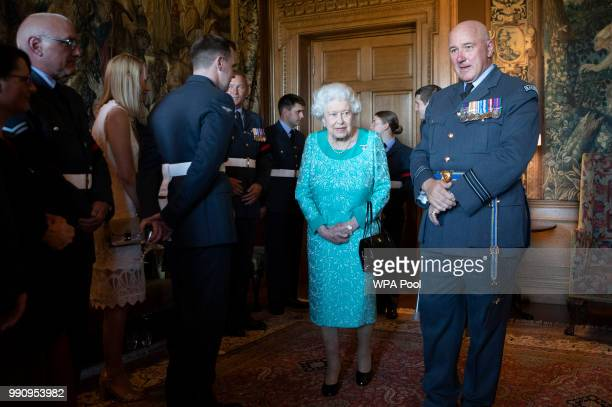 Queen Elizabeth II attends a reception for 603 Squadron Royal Auxiliary Air Force who have been honoured with the Freedom of The City of Edinburgh at...