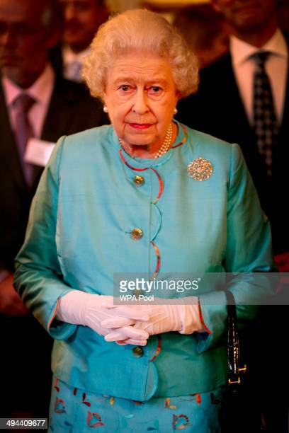 Queen Elizabeth II attends a reception for Leonard Cheshire Disability in the State Rooms St James's Palace on May 29 2014 in London England