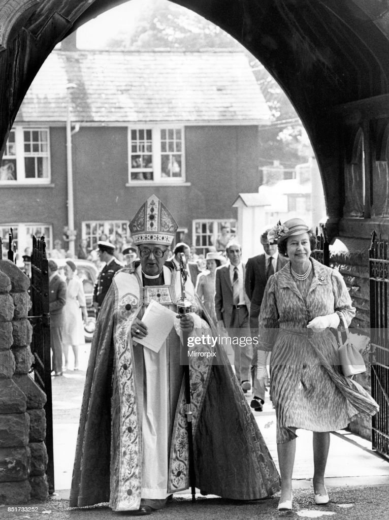 Queen Elizabeth II attends a service at Brecon Cathedral to celebrate the Diamond Jubilee of the Diocese of Swansea and Brecon, The Queen is pictured arriving at Brecon Cathedral with the Rt, Rev Benjamin Vaughan, Bishop of Swansea and Brecon, 21st July 1983.