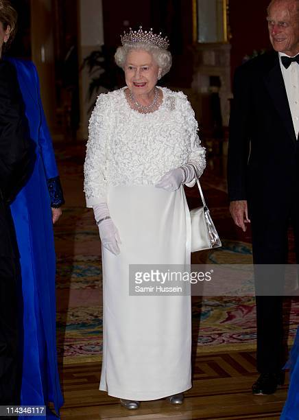 Queen Elizabeth II attends a State Dinner on May 18, 2011 in Dublin, Ireland. The Duke and Queen's visit to Ireland is the first by a monarch since...