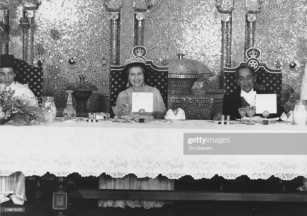 Queen Elizabeth II attends an official banquet in her honour at the royal palace in Rabat, Morocco, 27th October 1980. On the right is her host, King Hassan II of Morocco.
