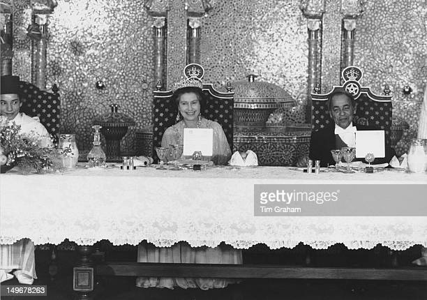 Queen Elizabeth II attends an official banquet in her honour at the royal palace in Rabat, Morocco, 27th October 1980. On the right is her host, King...