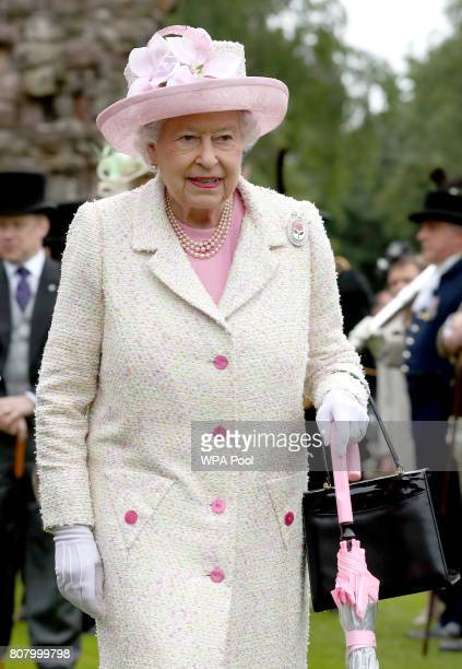 Queen Elizabeth II attends the annual garden party at the Palace of Holyroodhouse on July 4 2017 in Edinburgh Scotland