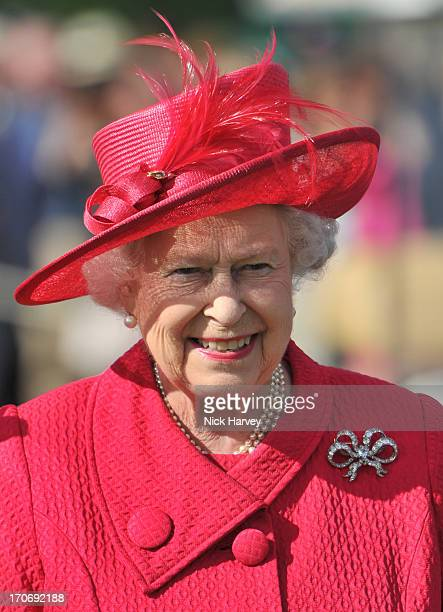 Queen Elizabeth II attends the Cartier Queen's Cup final at Guards Polo Club on June 16, 2013 in Egham, England.