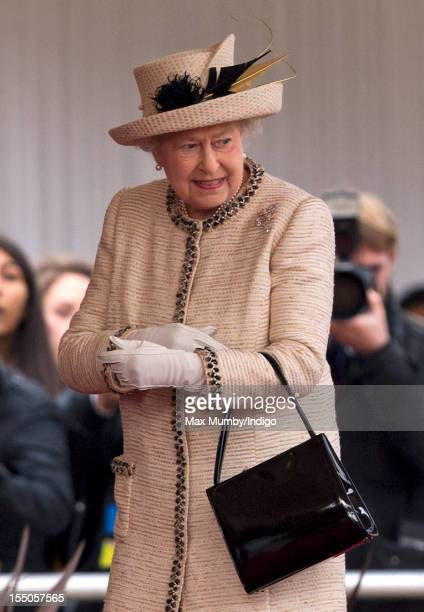 Queen Elizabeth II attends the ceremonial welcome for the President of the Republic of Indonesia at Horse Guards Parade on day one of his state visit...