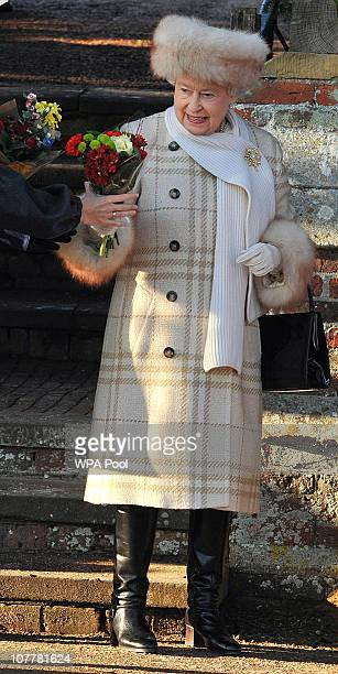 Queen Elizabeth II attends the Christmas Day Church Service with other members of the Royal family, at St Mary's Church on December 25, 2010 in...