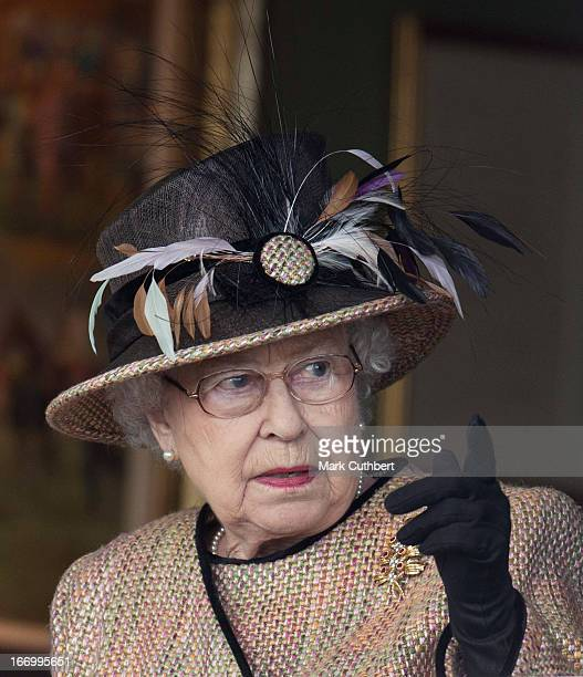 Queen Elizabeth II attends The Dubai Duty Free Raceday where she watched her horse Sign Manual win Race 5 The Dreweatts Handicap Stakes at Newbury...