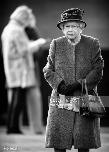 Queen Elizabeth II attends the Dubai Duty Free Spring Trials horse racing meet at Newbury Racecourse on April 13, 2019 in Newbury, England.