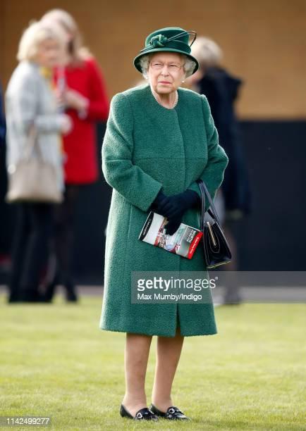 Queen Elizabeth II attends the Dubai Duty Free Spring Trials horse racing meet at Newbury Racecourse on April 13 2019 in Newbury England