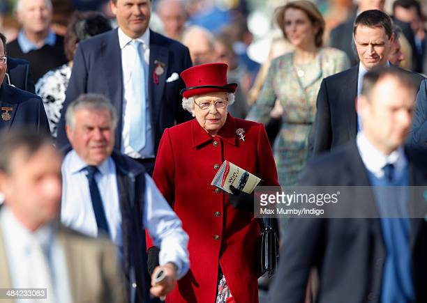 Queen Elizabeth II attends the Dubai Duty Free Spring Trials Meeting at Newbury Racecourse on April 11 2014 in Newbury England