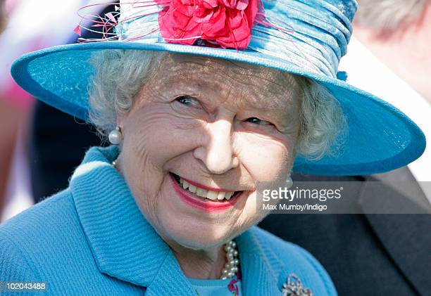 HM Queen Elizabeth II attends the final of the Harcourt Developments Queen's Cup polo tournament at Guards Polo Club on June 13 2010 in Egham England