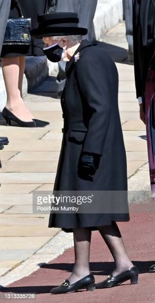 Queen Elizabeth II attends the funeral of Prince Philip, Duke of Edinburgh at St. George's Chapel, Windsor Castle on April 17, 2021 in Windsor,...