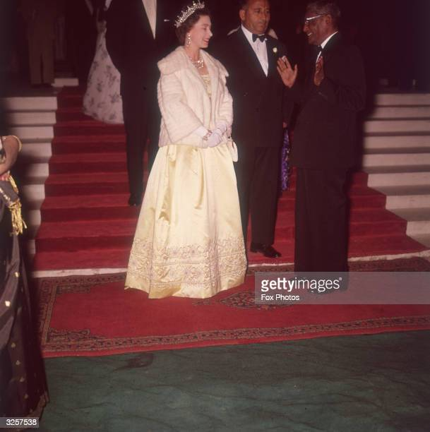 Queen Elizabeth II attends the governor of East Pakistan's dinner at Dacca during a royal tour 15th February 1961