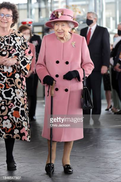 Queen Elizabeth II attends the opening ceremony of the sixth session of the Senedd at The Senedd on October 14, 2021 in Cardiff, Wales.