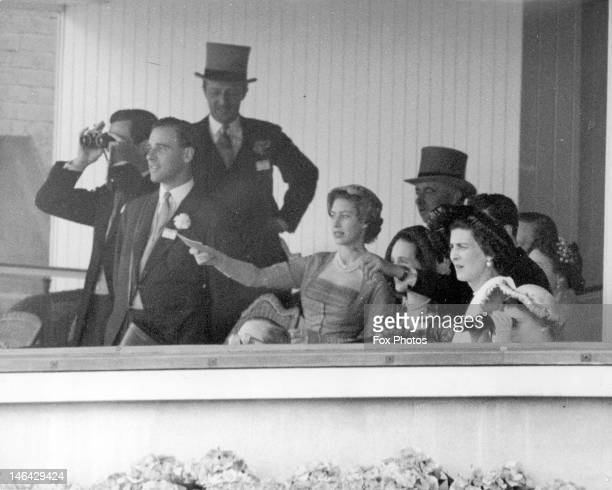 Queen Elizabeth II attends the opening meeting of Royal Ascot, her first since her accession to the throne, 17th June 1952. With her in the Royal Box...