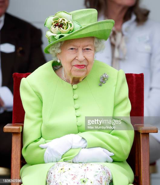 Queen Elizabeth II attends the Out-Sourcing Inc. Royal Windsor Cup polo match and a carriage driving display by the British Driving Society at Guards...