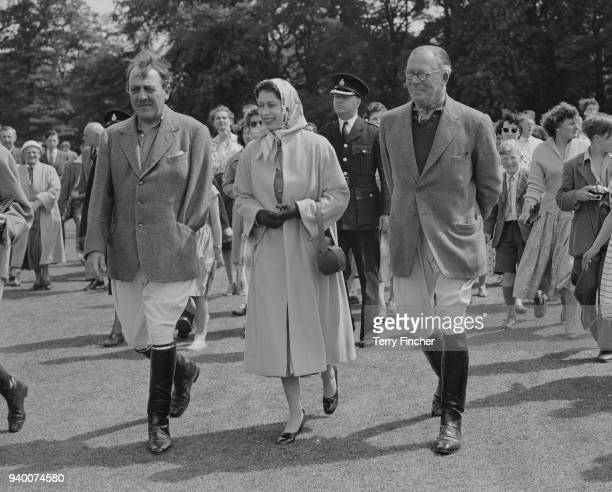 Queen Elizabeth II attends the return challenge polo match between Cowdray Park and a Windsor team led by the Duke of Edinburgh at Cowdray Park, UK,...
