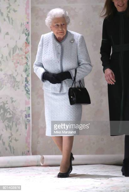 Queen Elizabeth II attends the Richard Quinn show during London Fashion Week February 2018 at BFC Show Space on February 20 2018 in London England