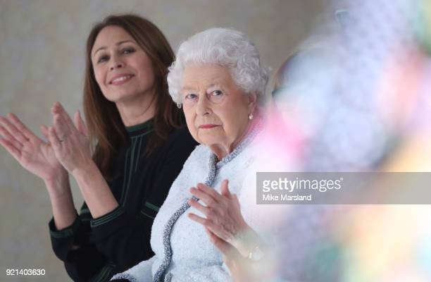 Queen Elizabeth II attends the Richard Quinn show with Chief Executive of the British Fashion Council Caroline Rush during London Fashion Week...