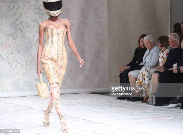 Queen Elizabeth II attends the Richard Quinn show with Chief Executive of the British Fashion Council Caroline Rush and Conde Nast Artistic Director...