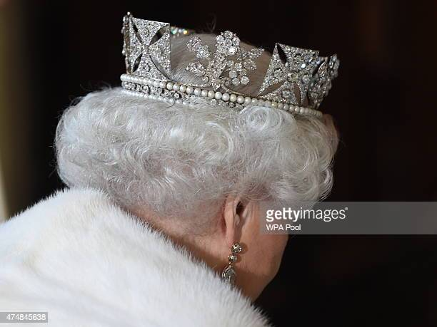 Queen Elizabeth II attends the State Opening of Parliament in the House of Lords at the Palace of Westminster on May 27 2015 in London England