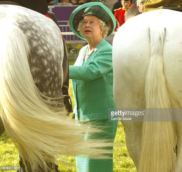 Queen Elizabeth II attends the third day of the Royal Windsor Horse Show at Home Park on May 15 2004 in Windsor England