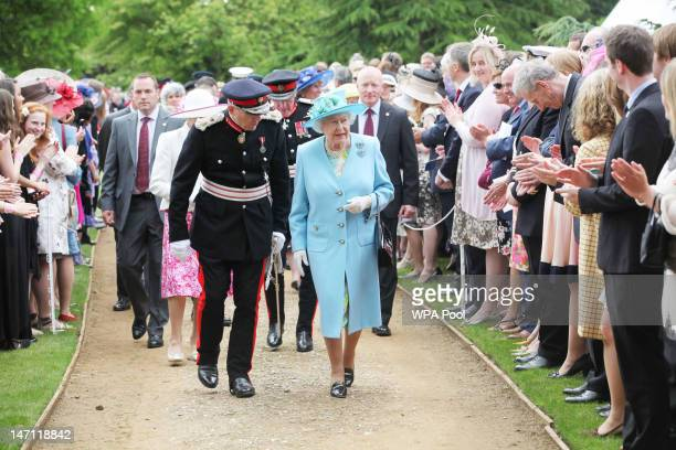 Queen Elizabeth II attends the Three Counties Diamond Jubilee River Pageant at the Henley Business College on June 25 2012 in Henley on Thames United...