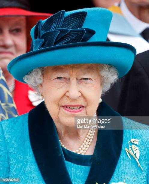 Queen Elizabeth II attends the traditional Royal Maundy service at Leicester Cathedral on April 13 2017 in Leicester England During the service The...
