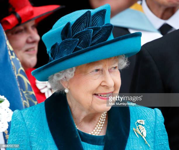 Queen Elizabeth II attends the traditional Royal Maundy service at Leicester Cathedral on April 13, 2017 in Leicester, England. During the service...