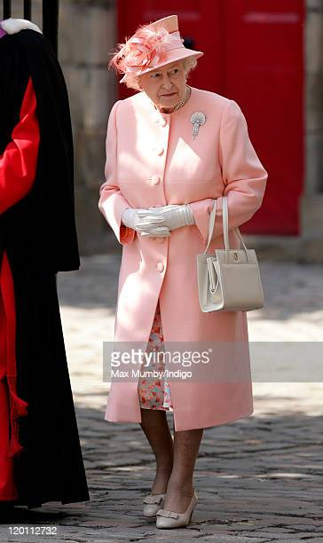 Queen Elizabeth II attends the wedding of Zara Phillips and Mike Tindall at Canongate Kirk on July 30, 2011 in Edinburgh, Scotland. The Queen's...