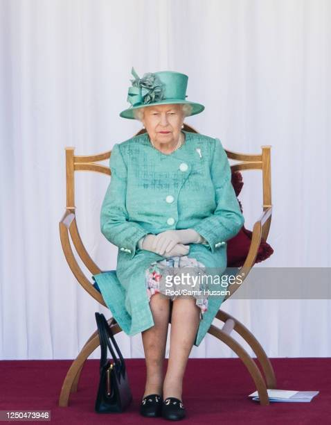 Queen Elizabeth II attends Trooping The Colour, the Queen's birthday ceremony at Windsor Castle on June 13, 2020 in Windsor, England. In line with...