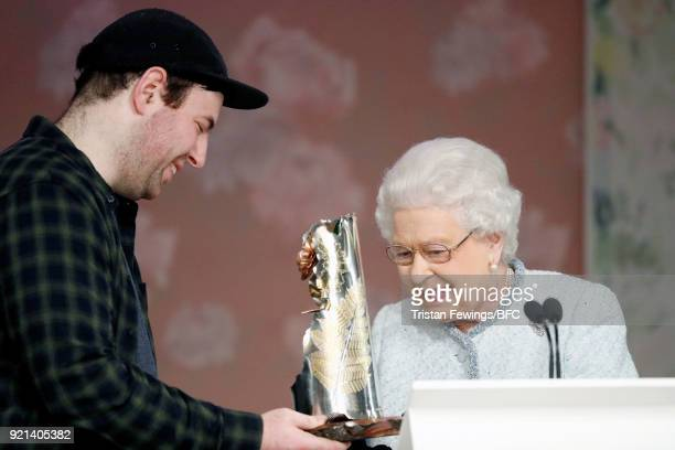 Queen Elizabeth II awards designer Richard Quinn the inaugural Queen Elizabeth II award for British Design during London Fashion Week February 2018...