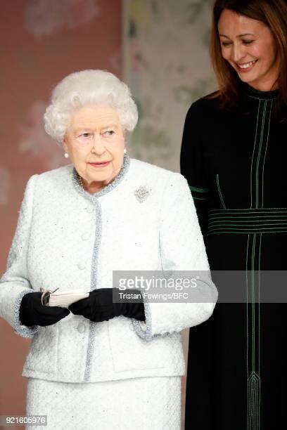 Queen Elizabeth II awards designer Richard Quinn the inaugural Queen Elizabeth II award for British Design alongside Chief Executive of the British...
