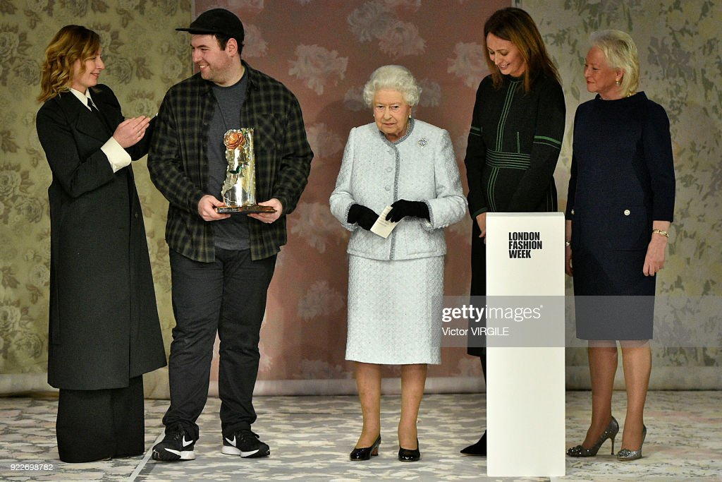 Queen Elizabeth II (C) awards designer Richard Quinn (2nd L) the inaugural Queen Elizabeth II award for British Design alongside Chief Executive of the British Fashion Council Caroline Rush (2nd R) and BFC Ambassador for Emerging Talent Sarah Mower (L) during London Fashion Week February 2018 on February 20, 2018 in London, England.