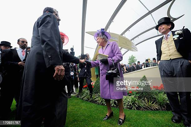 Queen Elizabeth II being congratulated with Sheikh Mohammed bin Rashid Al Maktoum and John Warren on Ladies' Day during day three of Royal Ascot at...