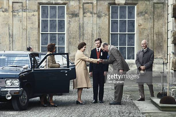 Queen Elizabeth II being greeted by Henry Somerset , 10th Duke of Beaufort, on her arrival at Badminton House for the Badminton Horse Trials,...