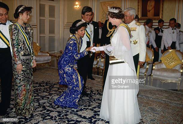 Queen Elizabeth II being greeted by the Malaysian Royal Family for a banquet