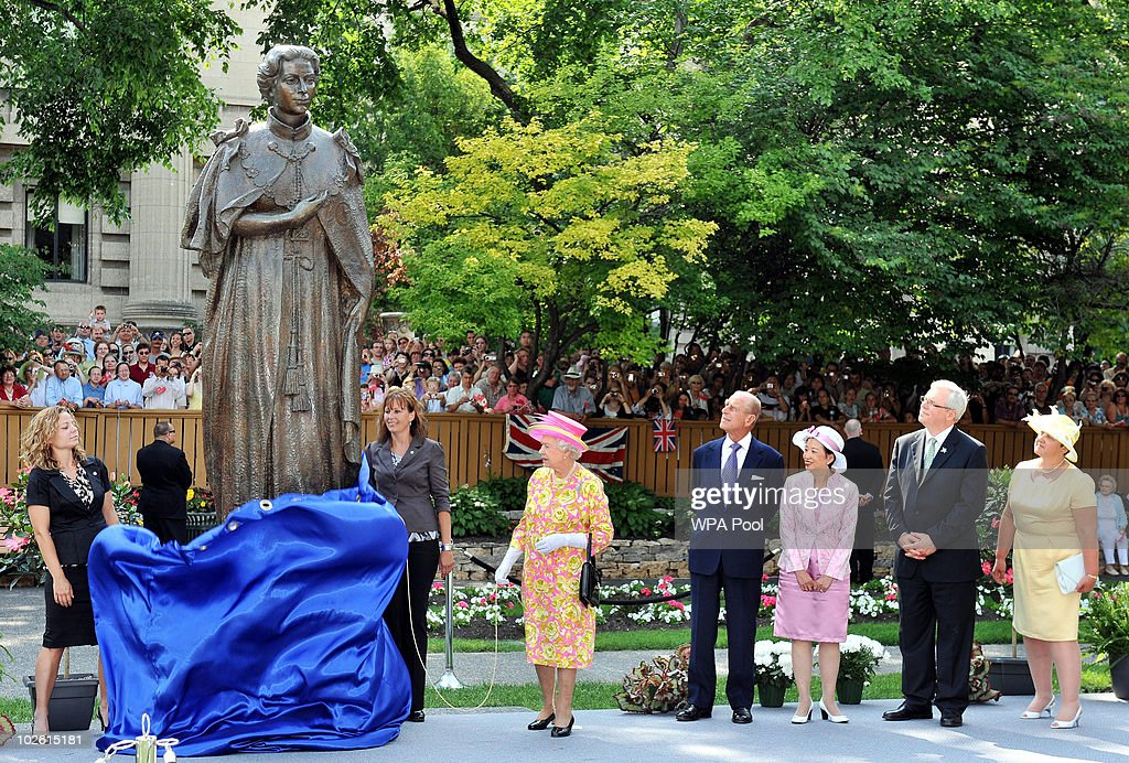 Queen Elizabeth II (C), beside Prince Philip, Duke of Edinburgh, unveils a statue of herself in the garden of Government House on July 3, 2010 in Winnipeg, Canada. The Queen and Duke of Edinburgh are on an eight day tour of Canada, starting in Halifax and finishing in Toronto, to celebrate the centenary of the Canadian Navy and to mark Canada Day on July 1st. On July 6th the royal couple will make their way to New York where the Queen will address the UN and visit Ground Zero.