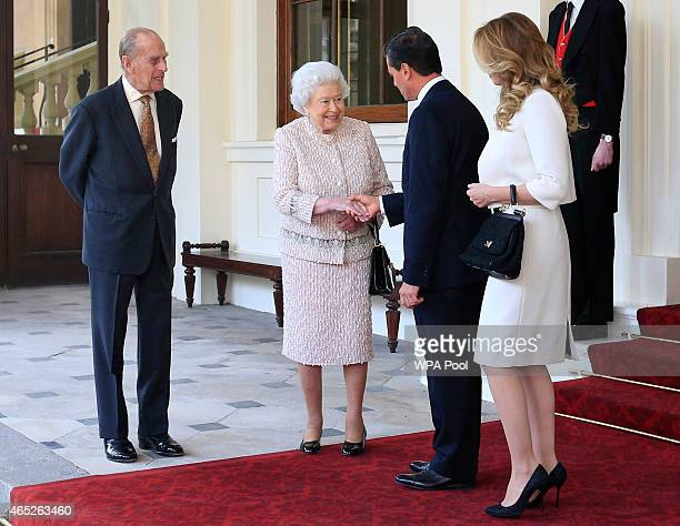 Queen Elizabeth II bids farewell to Mexican President Enrique Pena Nieto and Mexico's First Lady Angelica Rivera as Prince Philip Duke of Edinburgh...