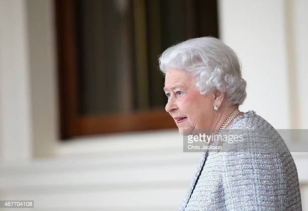 Queen Elizabeth II bids farewell to Singapore's President Tony Tan Keng Yam and his wife Mary at Buckingham Palace at the end of a State Visit on...