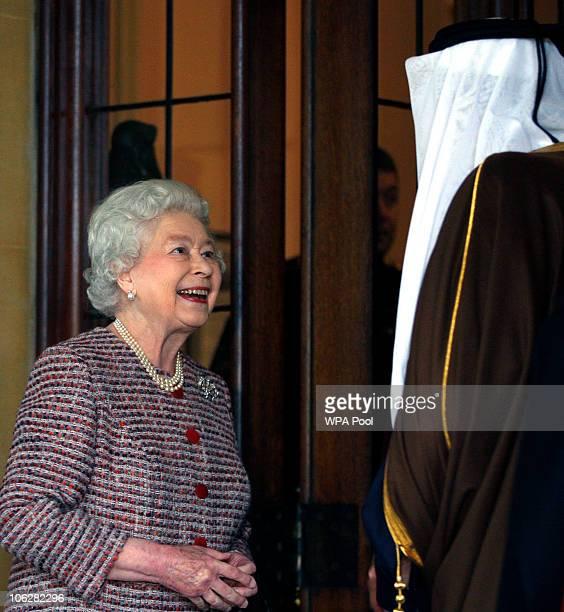 Queen Elizabeth II bids farewell to The Emir of Qatar Sheikh Hamad bin Khalifa AlThani at Windsor Castle on October 28 2010 in Windsor England Sheikh...