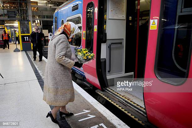 Queen Elizabeth II boards a First Capital Connect train at King's Cross Station on December 17 2009 in London England The Queen will travel to King's...