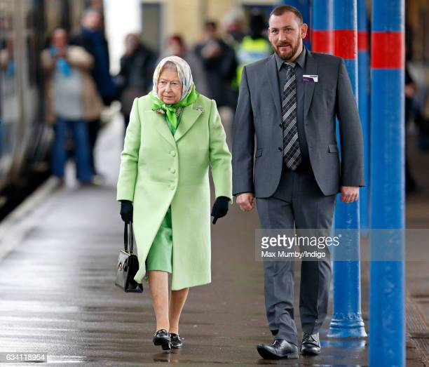 Queen Elizabeth II boards a train at King's Lynn Station to return to London after her Christmas break at Sandringham House on February 7 2017 in...